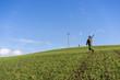 Gamekeeper walks over field.