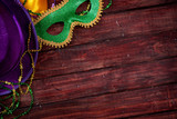 Mardi Gras: Mask And Purple Hat With Wood Background