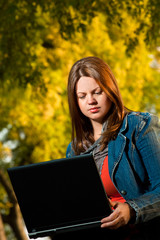 Beautiful young girl outdoor with laptop