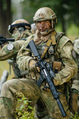 soldier stands with arms and looks forward