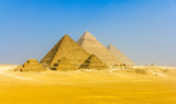 View of pyramids from the Giza Plateau: three Queens' Pyramids,