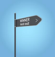 Winner next exit, dark grey road sign