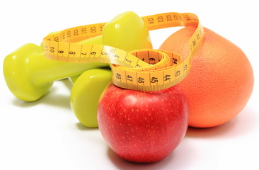 Fruits, tape measure and green dumbbells