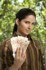 wad of banknotes woman