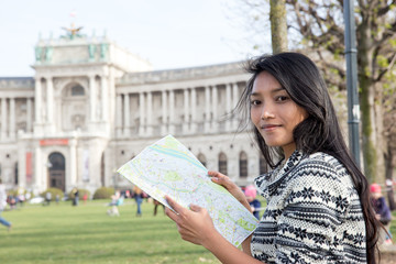 Young woman studying map near the Library