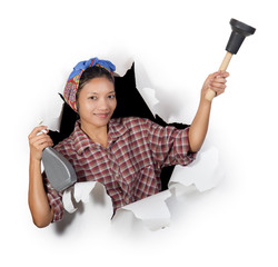 woman holding cleaning supplies in a paper hole