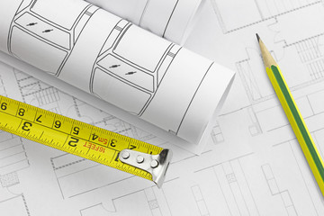 Tape measure and work tool, pencil over a construction plan draw