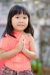 Cute Thai girl wearing typical Thai dress