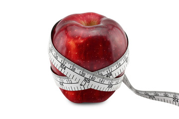 Red Apple with measuring tape on white background
