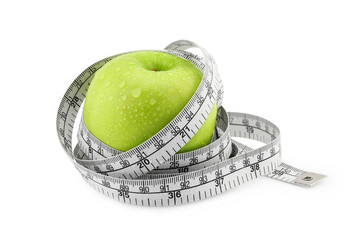 Green Apple with measuring tape on white background