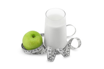 Green apple,glass of milk and measuring tape isolated on white.