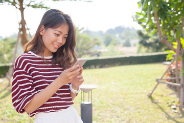 portrait of young beautiful woman reading message text on mobile