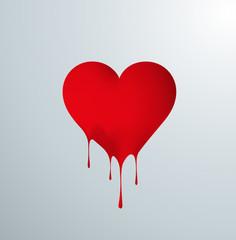 Corazón rojo derritiéndose en gotas por el calor. Amor y pasión
