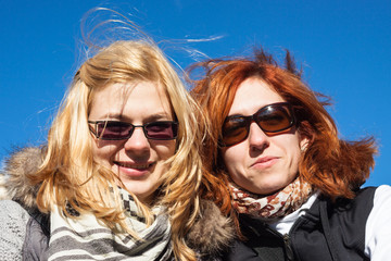 Happy girlfriends outdoors