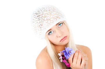 blond girl with a bouquet of violets