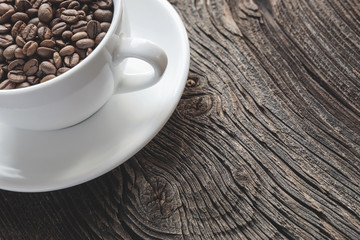 Cup of roasted coffeebeans
