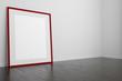canvas print picture - Roter leerer Rahmen steht auf dem Boden