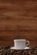 canvas print picture - Tasse Kaffee mit Hintergrund aus Holz