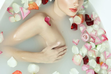 Beautiful sexy woman takes bath rose candles Valentine's day spa