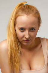 Sexy blonde girl expresses emotion anger, charity, hatred