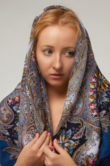 Blonde woman in colored shawl etnic style