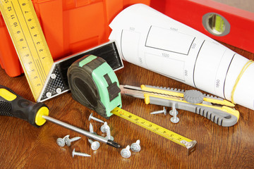 Many various working tools on a wooden table
