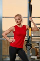Athletic woman trx