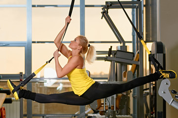 woman does splits with trx fitness