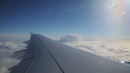 flying above the sky and looking outside the window of airplane