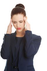 Young woman suffering a headache