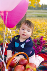portrait of nine-month baby in fall on lawn