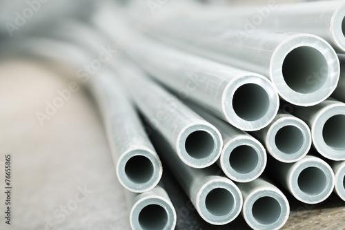 Leinwanddruck Bild Plastic industrial tubes closeup