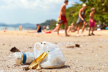 Garbage on a beach left by tourists, environmental pollution con