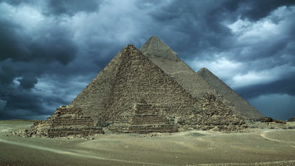 Timelapse with storm clouds over great pyramids at Giza Cairo in