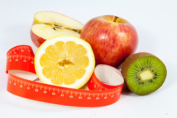 Tape measure and healthy fruit