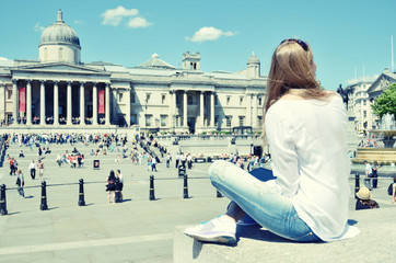 Girl on Trafalgar square in London