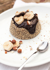Healthy paleo cake with dark chocolate, banana and hazelnuts