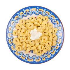 Ravioli dish on a white background