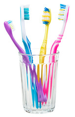 four toothbrushes in glass