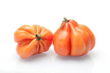 Dos tomates rosados