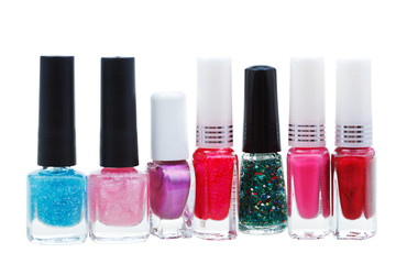 set of various nail polish isolated on white