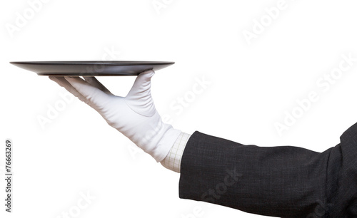 side view of hand in white glove with black plate - 76663269