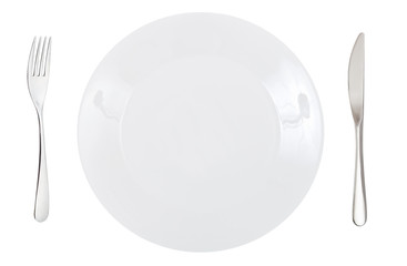 top view of porcelain dinner plate with cutlery
