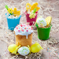 Easter cakes and colored eggs on a wooden background