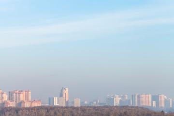 cold sunrise over city in winter