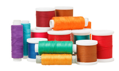 multicolored thread spools isolated on white