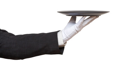 hand in white glove with black plate