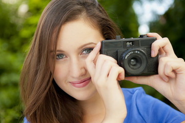 Young Girl Taking Photographs