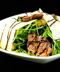 Salad with arugula and meat.