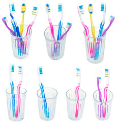 collection of toothbrushes in glases isolated